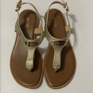 MK plate fly thong sandals